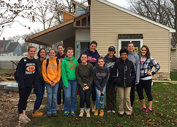 Bloomsburg University Honors students working with Habitat for Humanity
